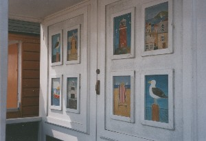 Seaside paintings on door of beach hut